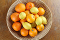 Citrus Fruits In A Basket Stock Photo - 28821390