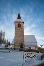A Wintertime View Of A Small Church With A Tall Steeple Royalty Free Stock Photography - 28829307