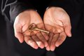 Brass Key In Cupped Male Hands Stock Image - 28845781
