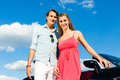 Young Couple With Cabriolet In Summer On Day Trip Stock Photos - 28876123