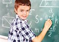 School Child Writting On Blackboard. Stock Images - 28880464