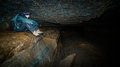 A Man Sitting In A Cave. Stock Image - 28881461