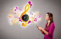 Pretty Girl Singing And Listening To Music With Musical Notes Royalty Free Stock Photography - 28894817