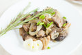 Oyster Mushrooms Cooked With Onions On A White Dish Royalty Free Stock Photography - 28935627