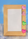 Wood Photo Frame With Multi-colored Hearts Royalty Free Stock Photography - 28945947
