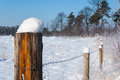 Wooden Pole Covered With Snow Stock Photography - 28950092