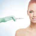 Portrait Of A Redhead Woman Getting An Injection Royalty Free Stock Images - 28963749