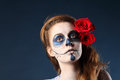 Pretty Zombie Girl With Painted Face And Two Red Roses Stock Photos - 28969213