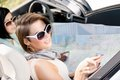 Girls With The Highway Map In The Car Stock Photos - 28978613