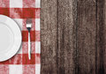 White Plate And Fork On Old Wooden Table Royalty Free Stock Photography - 28986037