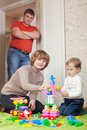 Parents And Child Plays With Meccano Royalty Free Stock Photography - 28990977