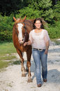 Young Adult Woman Walking Her Horse Stock Photo - 29012590