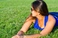 Woman Relaxing Lying On Grass Royalty Free Stock Photo - 29036845