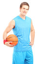 A Smiling Basketball Player Posing With A Ball In His Hand Stock Image - 29072921