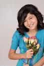 Cute Young Girl With Roses Stock Photography - 29075022