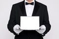 Butler Holding A Blank Card Upon A Silver Tray Royalty Free Stock Photo - 29082925
