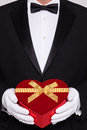 Man In Black Tie Holding A Heart Shaped Box Of Chocolates Royalty Free Stock Photo - 29083105
