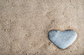 Stone Heart In Sand Stock Photography - 29087332