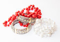 Two White Gold Bracelets And Red Necklace Stock Images - 29093444