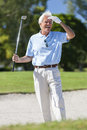 Happy Senior Man Playing Golf In Bunker Royalty Free Stock Photo - 29094135
