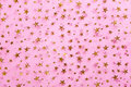 Gold Stars On Pink Textile Royalty Free Stock Photography - 29094727