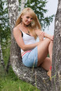 Pretty Girl Sit On Birch. Royalty Free Stock Photos - 2910298
