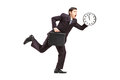 Busy Businessman Running With Wall Clock And Briefcase Royalty Free Stock Image - 29113676