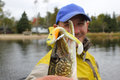 Fisherman Poses With Northern Pike Fish Royalty Free Stock Images - 29116479