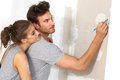 Young Couple Planning New Home Stock Image - 29117061