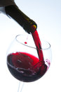 Red Wine Pouring Into Wine Glass Royalty Free Stock Image - 29127756