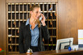 Reception Of Hotel - Desk Clerk Taking A Call Royalty Free Stock Photo - 29150935