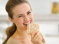 Happy Young Woman Eating Crisp Bread Stock Photos - 29191163