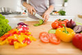Closeup On Young Woman Slicing Vegetables Stock Photography - 29191342