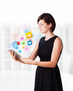 Young Woman Looking At Modern Tablet With Colourful Icons Royalty Free Stock Photos - 29238218