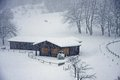 Wooden Chalet On The Italian Alps During A Heavy Snowfall Royalty Free Stock Photo - 29247015