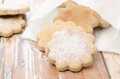 Figured Cookies Sprinkled With Powdered Sugar In A Paper Bag Stock Photo - 29258880