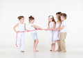 Five Little Children In White Clothes Draw Over Rope. Royalty Free Stock Photos - 29268878