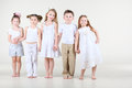 Four Little Girls And Boy In White Clothes Stands Stock Photos - 29268893