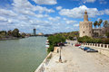 Guadalquivir River And Gold Tower In Seville Royalty Free Stock Photography - 29271237