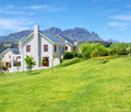 Cape-style House Against Blue Misty Mountains Royalty Free Stock Image - 29271746