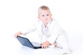 Little Business Boy In  Solid White Suit Sitting At Notebook. Stock Photo - 29291190