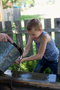 Boy Washes Well Water. Stock Photos - 29295253