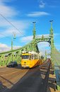 Orange Tram On The Liberty Bridge In Budapest, Hungary Royalty Free Stock Images - 29299959
