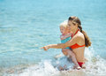Mother Showing Something To Baby Girl At Seaside Royalty Free Stock Photos - 29306108