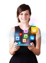 Young Woman Looking At Modern Tablet With Colourful Icons Stock Photography - 29316952