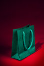Green Shopping Bag On Red Royalty Free Stock Photos - 29317168