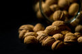 Walnuts Spilling Out Of A Glass Jar Royalty Free Stock Photography - 29329487
