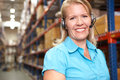 Businesswoman Using Headset In Distribution Warehouse Stock Photo - 29347430
