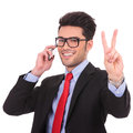 Business Man On Phone Shows Victory Sign Stock Photos - 29374513