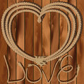 Heart Of Rope On A Wooden Background Stock Photos - 29374923